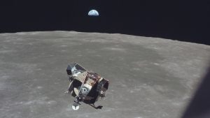 In this July 21, 1969 photo made available by NASA, the Apollo 11 Lunar Module ascent stage, carrying astronauts Neil Armstrong and Buzz Aldrin, approaches the Command and Service Modules for docking in lunar orbit. Astronaut Michael Collins remained with the CSM in lunar orbit while the other two crewmen explored the moon's surface. In the background the Earth rises above the lunar horizon. (Michael Collins/NASA via AP)