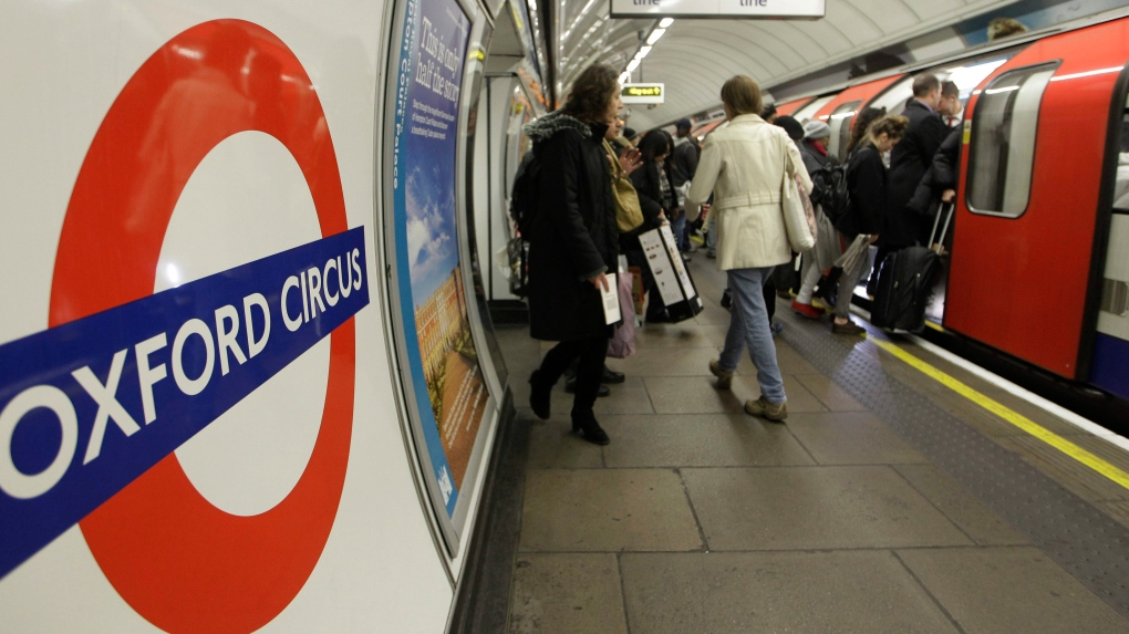 "People board an underground ""Tube"" train in London"