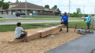 New seesaw bench unveiled at Winnipeg Trail