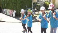"""On-stage and street performances took place throughout the day from 10 a.m. to 6 p.m., with local acts like indie-folk artist Steph MacPherson, dream pop performer Corduroy and an adorable group of fiddling kids called the """"Sizzlers Fiddle Group."""" (CTV)"""
