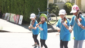 "On-stage and street performances took place throughout the day from 10 a.m. to 6 p.m., with local acts like indie-folk artist Steph MacPherson, dream pop performer Corduroy and an adorable group of fiddling kids called the ""Sizzlers Fiddle Group."" (CTV)"