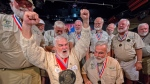 In this Saturday, July 20, 2019, photo provided by the Florida Keys News Bureau, Joe Maxey, second from left, celebrates his victory at the Hemingway Look-Alike Contest at Sloppy Joe's Bar in Key West, Fla. (Andy Newman/Florida Keys News Bureau via AP)