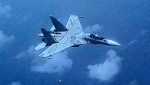 This image made from a Friday, July 19, 2019, video provided by the U.S. Southern Command shows a Venezuelan SU-30 fighter jet over the Caribbean. (U.S. Southern Command/Department of Defense via AP)