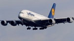 An Airbus A 380 of Lufthansa airline approaches the airport in Frankfurt, Germany, Thursday, Feb. 14, 2019. (AP Photo/Michael Probst)