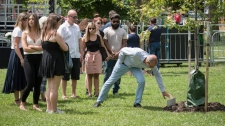 Family members of the late Reese Fallon gather near a tree planted in her honour during a Danforth shooting commemoration at Withrow Park in Toronto on Sunday, July 21, 2019. THE CANADIAN PRESS/ Tijana Martin