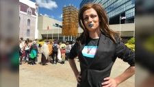 """Peanut Butter Tuck"" performed in drag at a rally held Sunday outside Calgary city hall in support of Gay Straight Alliances. They credit the inclusion club at their small town school for saving their lives."