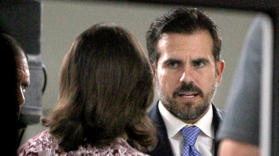 In this file photo, Puerto Rico Gov. Ricardo Rossello meets with mayors from his party inside the Yolanda Guerrero Cultural Center in Guaynabo, Puerto Rico, Sunday, July 21, 2019. Rossello will be resigning on August 2, but it's unclear who his replacement will be. (Pedro Portal/Miami Herald via AP)