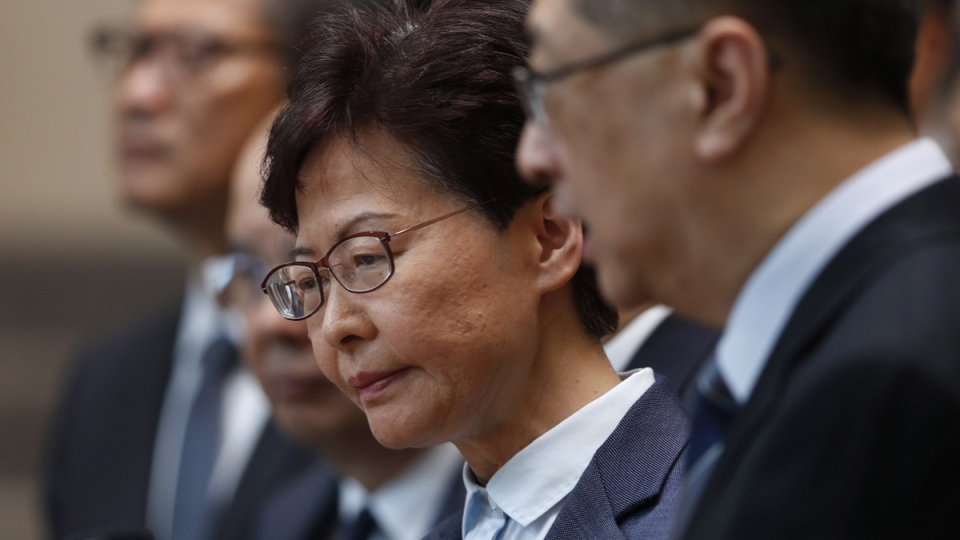 Hong Kong Chief Executive Carrie Lam, centre, reacts during a press conference in Hong Kong, on July 22, 2019. (Vincent Yu / AP)