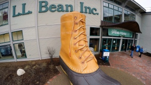 In this March 16, 2016, file photo, shoppers exit the L.L. Bean retail store in Freeport, Maine. (AP Photo/Robert F. Bukaty, File)
