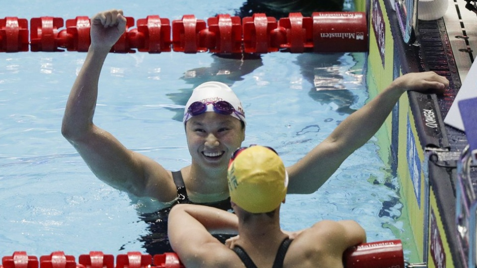 London's Margaret MacNeil reacts after winning the women's 100m butterfly final at the World Swimming Championships in Gwangju, South Korea, Monday, July 22, 2019. (AP Photo/Mark Schiefelbein)