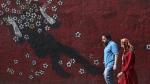 People walk past a mural in downtown Tehran, Iran, on July 21, 2019. (Vahid salemi / AP)