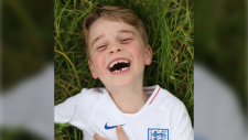 In this undated photo released by the Duke and Duchess of Cambridge on Sunday, July 21, 2019, Prince George poses for a photo taken by his mother, Kate, the Duchess of Cambridge, in the garden of their home at Kensington Palace, London. Prince George turns six today, Monday, July 22. (The Duchess of Cambridge via AP)