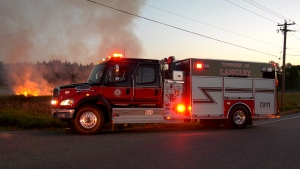 Fire crews were in Langley on Sunday, July 21 after a grass fire burned for several hours.