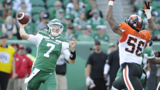Saskatchewan Roughriders quarterback Cody Fajardo attempts a pass under pressure from BC Lions' Korey Toomer (56) during first half CFL action at Mosaic Stadium in Regina on Saturday, July 20, 2019. THE CANADIAN PRESS/Mark Taylor