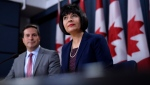 Minister of Health, Ginette Petitpas Taylor and Liberal MP Marco Mendicino, left, speak at a press conference regarding the Canada Food Guide and their letter to Conservative leader Andrew Scheer, at the National Press Theatre in Ottawa on Monday, July 22, 2019. THE CANADIAN PRESS/Justin Tang