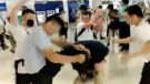In this image taken from a video footage run by The Stand News via AP Video, white shirted men attacked a man dressed in black shirt at a subway station in Hong Kong on Sunday, July 21, 2019. China doesn't want to intervene in Hong Kong's protests but that doesn't mean it won't, as a thuggish attack on the protesters brought accusations of connivance between police and criminal gangs. (The Stand News via AP Video)