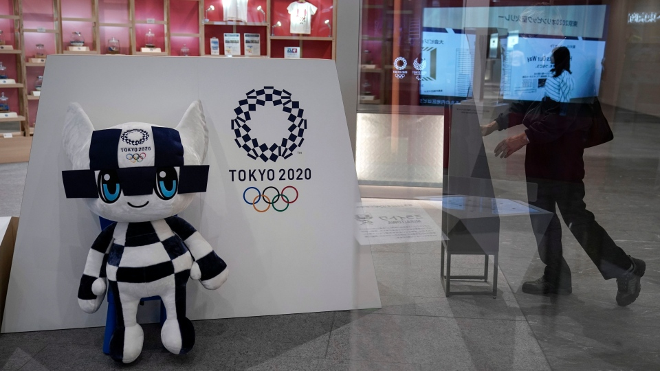 In this June 11, 2019, file photo, Miraitowa, a mascot for the Tokyo 2020 Summer Olympics, is displayed at an Olympic Corner in Tokyo. Scandals and rising costs have not deterred interest in Japan in the Tokyo Olympic. (AP Photo/Jae C. Hong, File)