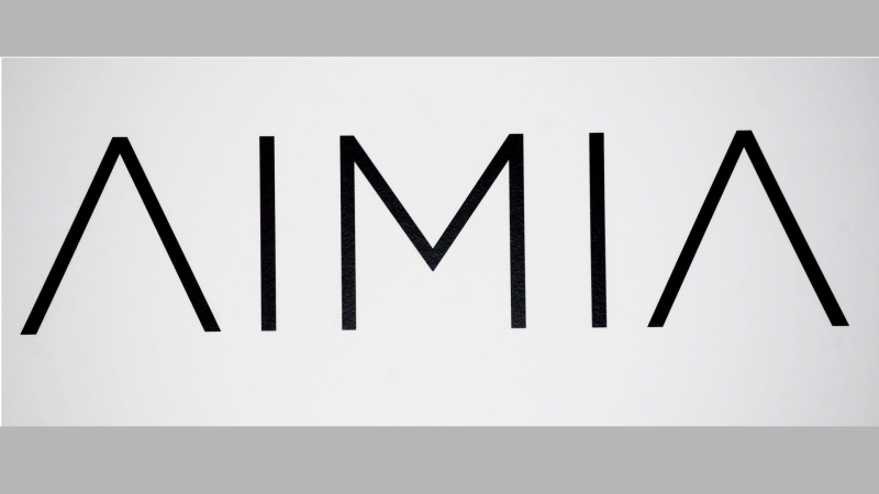 An AIMIA logo is shown at the company's annual general meeting in Montreal, on May 4, 2012. THE CANADIAN PRESS/Graham Hughes