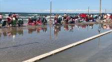 Seen here, the beach dramatically reduced in Wasaga Beach, Ont.  because of high water levels on July 21, 2019 (CTV Barrie Aileen Doyle)