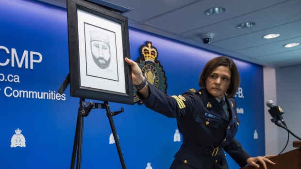 RCMP Sgt. Janelle Shoihet places a sketch of a man who the RCMP say interacted with Lucas Fowler and Chynna Deese on a stand during a news conference, in Surrey, B.C., on Monday July 22, 2019. THE CANADIAN PRESS/Darryl Dyck
