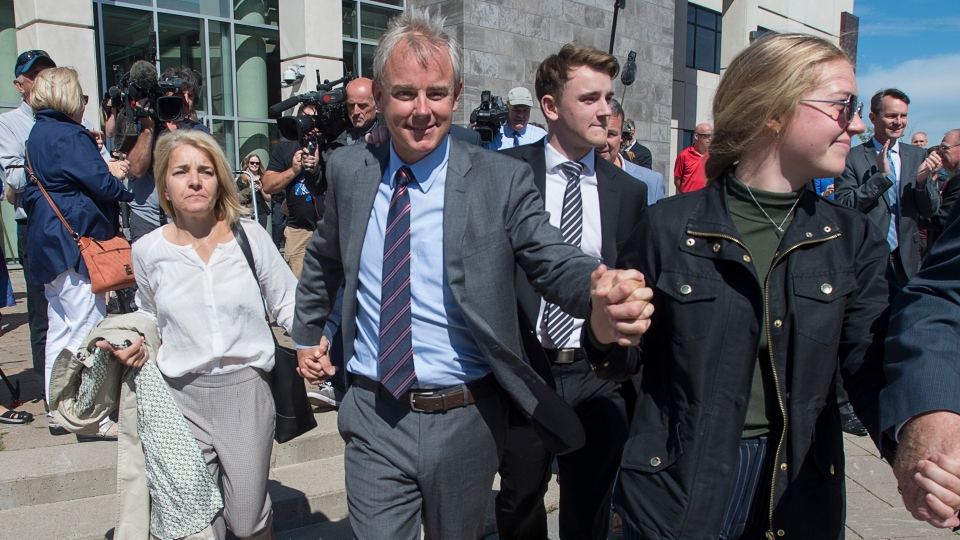 Dennis Oland and family members head from the Law Courts in Saint John, N.B., after he was found not guilty of murdering his father on Friday, July 19, 2019. THE CANADIAN PRESS/Andrew Vaughan