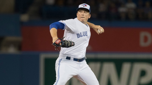 Toronto Blue Jays starting pitcher Ryan Borucki throws during first inning American League MLB baseball action against the Cleveland Indians, in Toronto, Monday, July 22, 2019. THE CANADIAN PRESS/Fred Thornhill