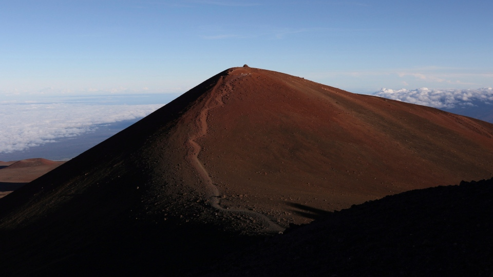 This July 14, 2019, file photo shows the summit of Hawaii's Mauna Kea. For activists who say they're protecting Mauna Kea, the fight against the proposed Thirty Meter Telescope is a boiling point in Hawaiian history: the overthrow on the Hawaiian kingdom, battles over land, water and development and questions about how the islands should be governed. (AP Photo/Caleb Jones, File)