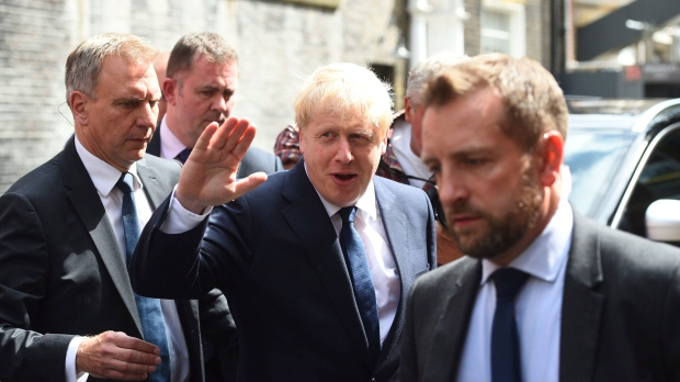 Conservative Party leadership contender Boris Johnson, centre, leaves his office in Westminster area of London, Monday July 22, 2019. Voting closes Monday in the ballot to elect Britain's next prime minister, from the two contenders Jeremy Hunt and Boris Johnson.(Kirsty O'Connor/PA via AP)