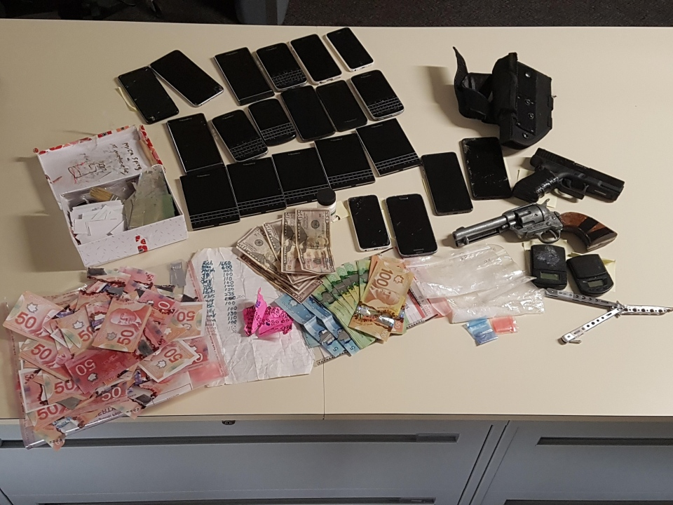 WRPS make bust in Cambridge seizing drugs, weapons and fake money (WRPS_