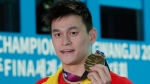 China's Sun Yang poses with his gold medal following the men's 200m freestyle final at the World Swimming Championships in Gwangju, South Korea, Tuesday, July 23, 2019. (AP Photo/Lee Jin-man)