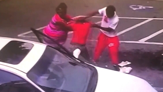 This image taken from video shows several people fighting outside a beauty supply store in Moultrie, Ga. (Source: WTXL via CNN)