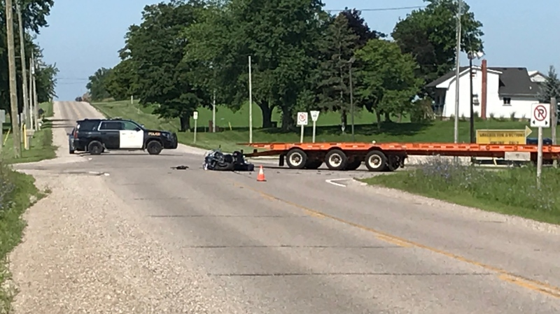 A motorcycle and a flatbed truck were involved in a crash northeast of Aylmer on Tuesday, July 23, 2019. (Sean Irvine / CTV London)