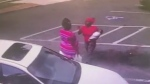 Image from video before a fight outside a beauty supply store in Moultrie, Ga. (source: WTXL via CNN)