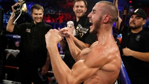 In this Saturday, Oct. 20, 2018 file photo, Maxim Dadashev celebrates after defeating Antonio DeMarco during a junior welterweight bout in Las Vegas.  (AP Photo/John Locher)
