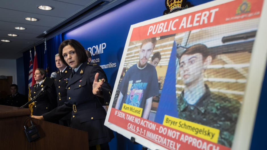 Security camera images recorded in Saskatchewan of Kam McLeod, 19, and Bryer Schmegelsky, 18, are displayed as RCMP Sgt. Janelle Shoihet speaks during a news conference in Surrey, B.C., on Tuesday July 23, 2019. (Darryl Dyck / The Canadian Press)