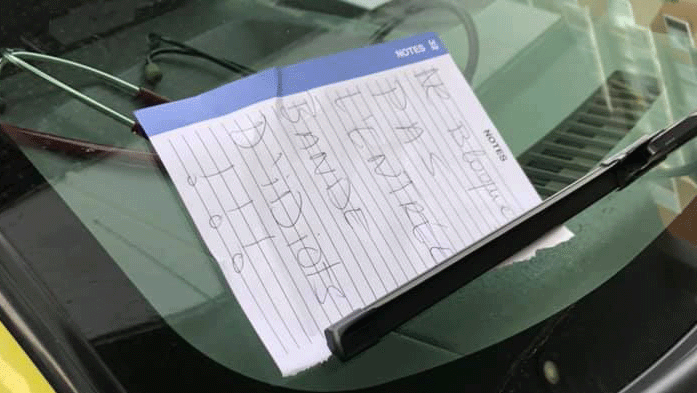 A note left on an ambulance windshield