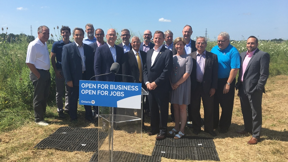 Government officials and business leaders gather to announced Element5's new timber plant in St. Thomas, Ont. on Tuesday, July 23, 2019. (Brent Lale / CTV London)