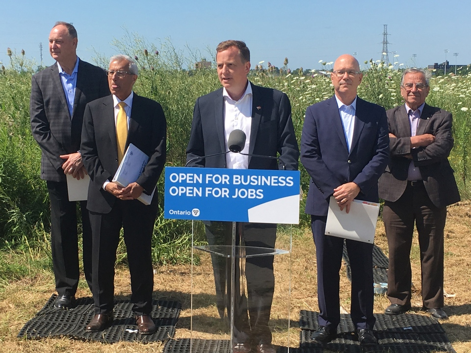 Elgin-Middlesex-London MPP Jeff Yurek, center, discusses the new Element5 timber plant in St. Thomas, Ont. on Tuesday, July 23, 2019. (Brent Lale / CTV London)