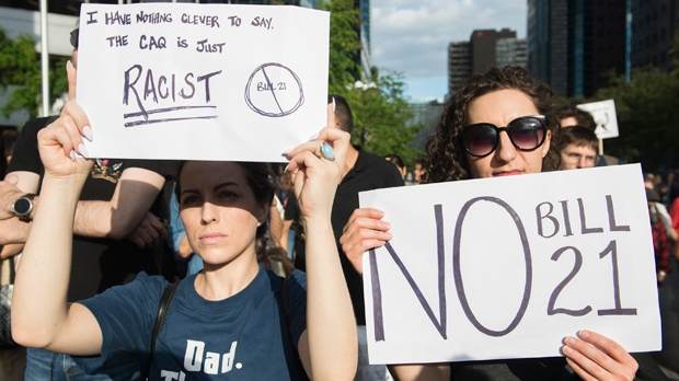People attend a demonstration to protest against the Quebec government's Bill 21 in Montreal, Monday, June 17, 2019. THE CANADIAN PRESS/Graham Hughes