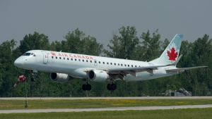 An Air Canada flight makes its final approach as it lands on July 3, 2019 in Ottawa. THE CANADIAN PRESS/Adrian Wyld