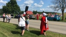 Pro-choice protestors, some dressed as characters from the Handmaid's Tale, took to the street outside of Kitchener-Conestoga MP Harold Albrecht's fundraiser on Tuesday. (Natalie van Rooy / CTV Kitchener)