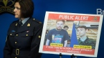 Security camera images recorded in Saskatchewan of Kam McLeod, 19, and Bryer Schmegelsky, 18, are displayed as RCMP Sgt. Janelle Shoihet listens during a news conference in Surrey, B.C., on Tuesday July 23, 2019. THE CANADIAN PRESS/Darryl Dyck