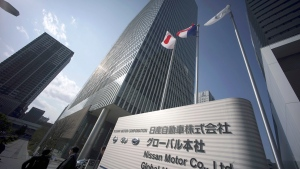 In this March 12, 2019, file photo, Japanese and French flags are hoisted at the entrance to the Nissan headquarters where Renault, Nissan and Mitsubishi Motors board meeting takes place in Yokohama, near Tokyo. (AP Photo/Eugene Hoshiko, File)