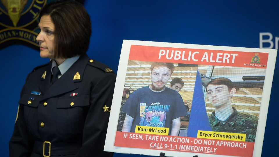 Security camera images recorded in Saskatchewan of Kam McLeod, 19, and Bryer Schmegelsky, 18, are displayed as RCMP Sgt. Janelle Shoihet listens during a news conference in Surrey, B.C., on Tuesday July 23, 2019. (The Canadian Press / Darryl Dyck)
