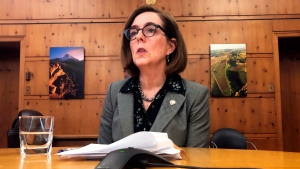 In this Monday, July 1, 2019 file photo, Oregon Gov. Kate Brown speaks with the media at the Capitol in Salem, Ore. Legislation allowing certain terminally ill patients to have quicker access to life-ending medications under the state's first-in-the-nation assisted suicide law has been signed into law, Gov. Brown's office announced Wednesday, July 24. (AP Photo/Sarah Zimmerman, File)