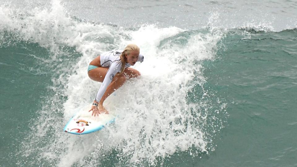Bethany Hamilton surfing in Haleiwa, Hawaii, on March 14, 2006. (Carol Cunningham / AP)