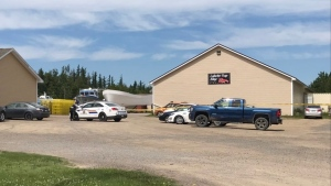 Police responded to a fishing supply store in Pointe-Sapin, N.B., on July 25, 2019. Two people were found dead inside the store. (Eilish Bonang/CTV Atlantic)