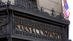 An ironwork logo adorns the facade of Saks flagship store on New York's Fifth Avenue, Monday, July 29, 2013. (AP Photo/Richard Drew)