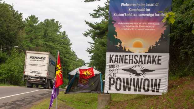 Mohawk flags are placed at the border of the Kanasatake Mohawk territory Friday, July 19, 2019 in Oka, Que. THE CANADIAN PRESS/Ryan Remiorz