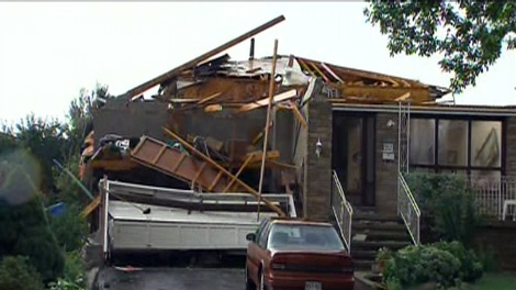 A home is all but destroyed on Houston Road in Vaughan on Thursday, Aug. 20, 2009.